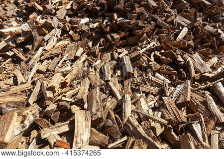 A Background Image Of A Pile Of Wooden Logs Cut Into Different Shapes And Sizes And Scattered Irregu