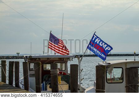 Rock Hall, Md ,usa 08/18/2020: Trump 2020 Flag Waving On A Flag Post At The Back Of A Boat. The Flag