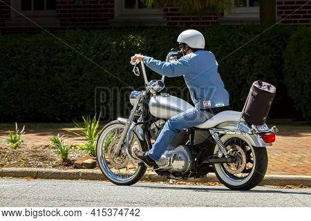 Chestertown, Md, Usa 08/30/2020: A Man Wearing Helmet, Jeans And A Casual Coat Is Riding A Vintage M