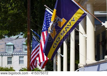 Annapolis, Md 08/21/2020: American Flags And Navy Football Team Flags Are Flying On Post On A Sunny