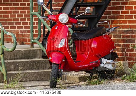 Frederick, Md, 08/14/2020: An Isolated Image Of A Red Vintage Vespa Gt200 Scooter Motorbike That Is