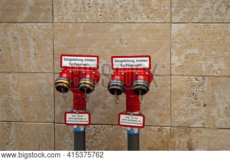 Berlin, Germany 09/14/2009: An Isolated Red Metal Dry Riser Standpipe System For Use By Fire Brigade