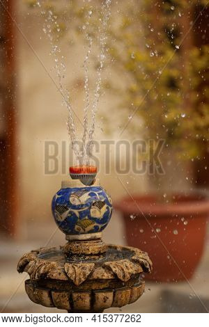 An Old Traditional Fountain With A Contemporary Plastic Sprinkler System. Close Up Image Of A Founta