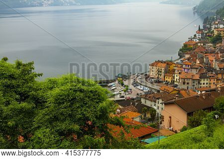 An Aerial View Of Argegno, Como A Town On The Foothills Of A Mountain And On The Coast Of Scenic Lak