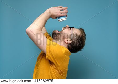 Man Is Tormented By Thirst, He Threw Back Head, Opened Mouth And Pours The Last Drops From A Paper,