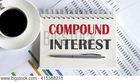 Compound Interest Text Written On Notebook With Pen And Chart