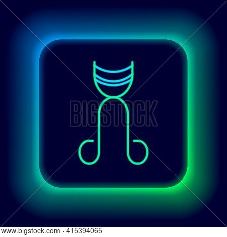 Glowing Neon Line Eyelash Curler Icon Isolated On Black Background. Makeup Tool Sign. Colorful Outli