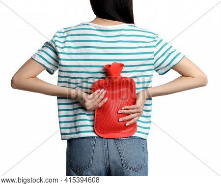 Woman Using Hot Water Bottle To Relieve Low Back Pain On White Background, Closeup