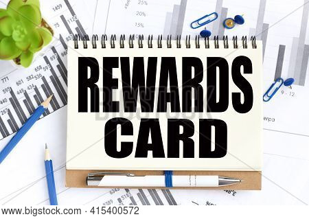 Reward Card. Text On White Notepad Paper On Light Background