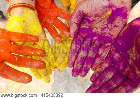 Young People With Colorful Powder In Hands At Holi Festival In India Celebrated With Different Color