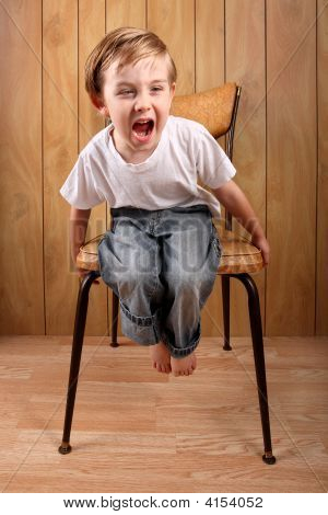 Boy Throwing A Tantrum While On A Time Out