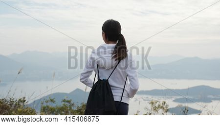 Woman enjoy go hiking and stand on the top of mountain