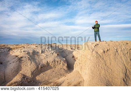 senior male drone pilot in a rugged terrain of Pawnee National Grassland in northern Colorado