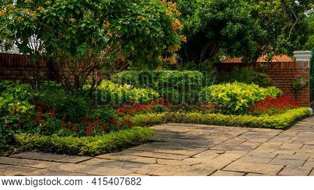 Back - Front Yard English Cottage Garden, Colorful Flowering Plant, Brown Pavement And Orange Brick