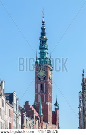 Clock Tower Of Gdansk Town Hall. Historic Ratusz Located In The Gdansk Main City Borough Of Srodmies