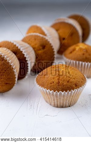Biscuit Muffins Close-up. Sweet Pastries. Party Treat. Dessert On White Table - Homemade Muffins. Po