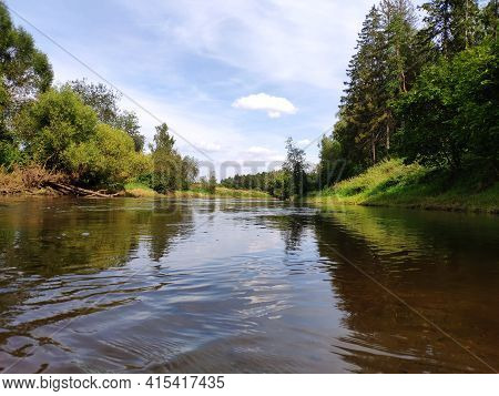 Wide River In The Forest, Sky With Clouds