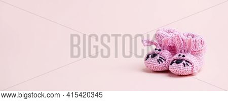 Cute Pink Newborn Baby Girl Shoes With Funny Bunny Rabbit Decoration Over Pink Background. Baby Show