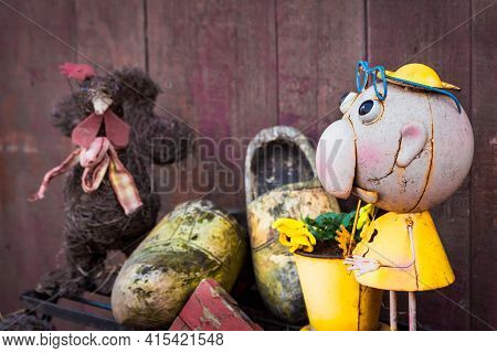 Netherlands Wooden Shoes, Clogs, Against Wooden  Wall And Dolls