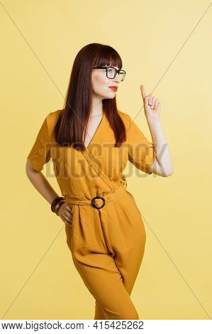 Studio Portrait Or Young Confident Conceived Attractive Young Woman In Eye Glasses And Stylish Yello