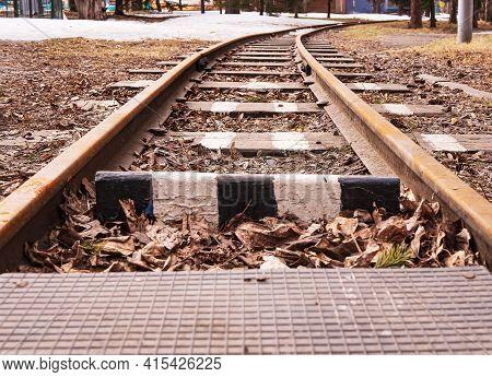 Children Railway Tracks Of The Children's Railway In Urban Public Park. Narrow-gauge Railway. Close-