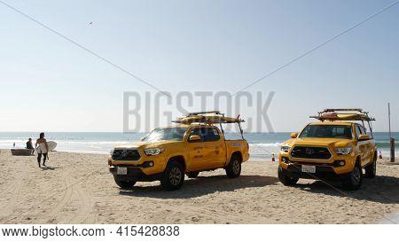 Oceanside, California Usa - 8 Feb 2020: Yellow Lifeguard Car, Beach Near Los Angeles. Coastline Resc