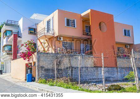 Typical Orange Residence Hotel Condominium Building Playa Del Carmen Mexico.