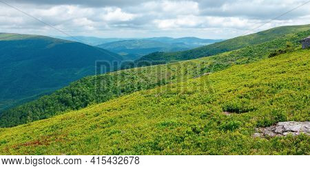 Stones On The Hill Of Mountain Meadow. Beautiful Summer Landscape With Clouds Above The Horizon