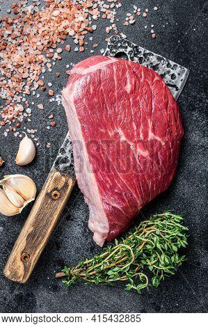 Fresh Raw Rump Beef Cut Or Top Sirloin Cap Steak On Butcher Cleaver. Black Background. Top View