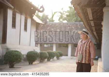 Old Elderly Elder Woman Traveller Traveling In Asian Temple. Senior Leisure Lifestyle