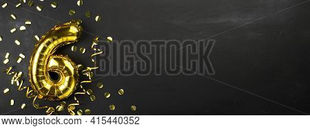 Gold Foil Balloon Number Six Or Six. Birthday Greeting Card With The Inscription 6. Black Concrete B