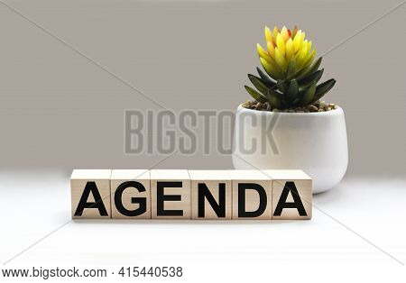 Agenda - Words From Wooden Blocks With Letters, List Of Issues On The Agenda Concept, White Backgrou