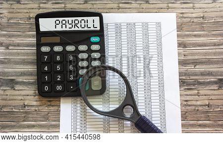 Payroll Word On Calculator. Business And Financial Concept