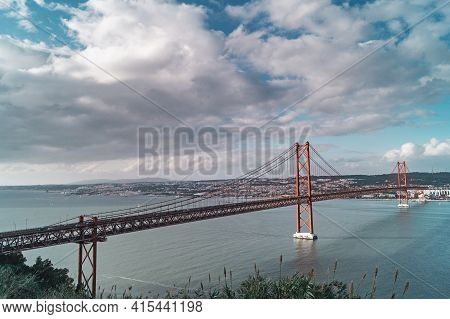 A View Of The Tagus River And Bridge The 25 April In Lisbon, Portugal.