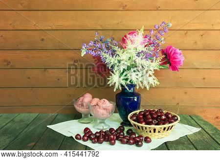 Beautiful Bouquet In Blue Vase, Glass Bowls With Cherry Ice Cream And Basket Of Fresh Cherry On Rust