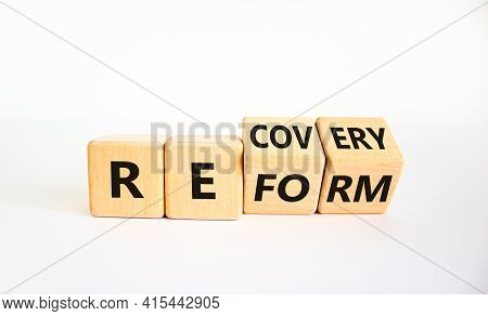 Recovery And Reform Symbol. Turned Cubes And Changed The Word 'recovery' To 'reform'. Beautiful Whit