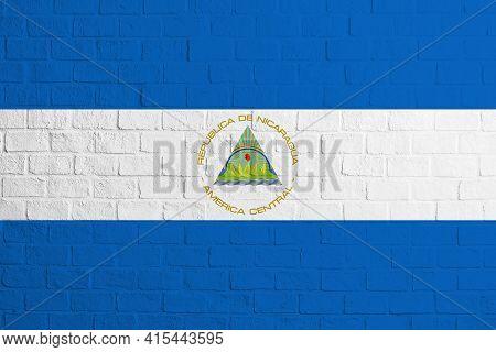 Flag Of Nicaragua. Brick Wall Texture Of The Flag Of Nicaragua.