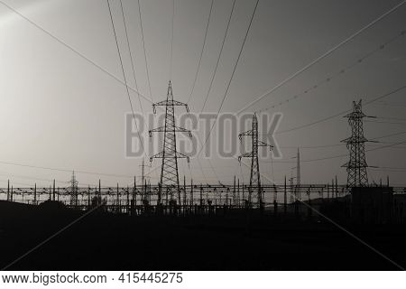 High-voltage Transmission Lines With High Voltage Outdoors In The Evening.black And White Photos.