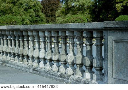 Balustrade Of Stone Columns Lit By The Sun