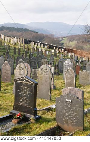 Conwy, Wales - March 02, 2012. Cemetery With Old Graves In Welsh Countryside. Snowdonia Scene, Capel