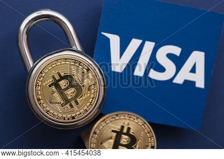 London, Uk - March 2021: Bitcoin Cryptocurrency On Visa Financial Service Logo