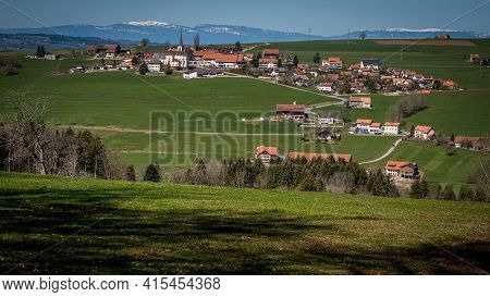 Idyllic Landscape. Panoramic View Of Saint Martin Village With Agricultural Field And Trees, Switzer