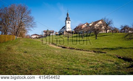 Idyllic Landscape. Panoramic View Of Switzerland Village With Agriculture Field, Church And Houses.