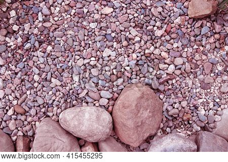 Big Round Stones And Small Pebbles Of Different Shape And In Different Shades Of Pink Color As A Bac
