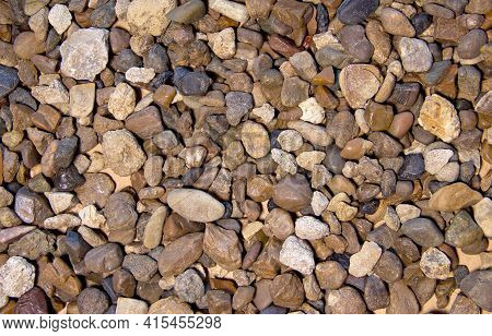 Pebbles Of Different Shape, Size, Color And Origin As A Background