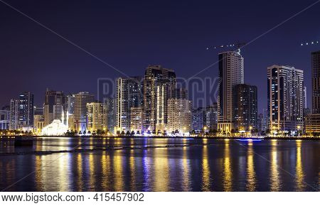 Sharjah,UAE,Dec 2nd 2020. Panoramic view of the illuminated sky scrappers along with the famous Al Noor mosque showing beautiful reflections in water captured at the Al Majaz waterfront Sharjah , UAE.
