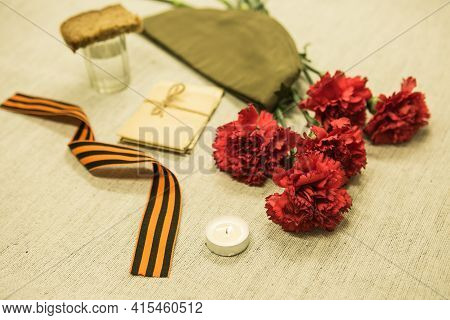Victory Day. We Remember The Exploits Of Our Grandfathers. Front Cap, Candle, Letters From The Front