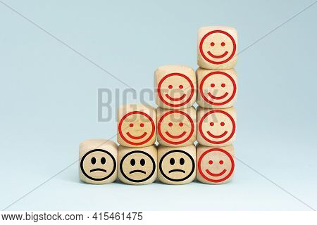 Wooden Block With Happy And Unhappy Face. Customer Service Rating Or Satisfaction Concept.business S