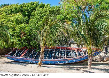 Old Red And Orange Boat On Tropical Beach