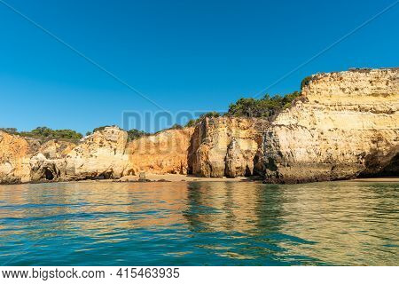 Natural Caves And Beach, Algarve Portugal. Rock Cliff Arches Of Seven Hanging Valleys And Turquoise